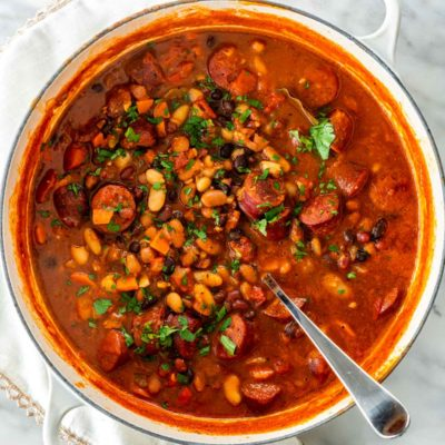 A pot full of delicious beans and sausage stew