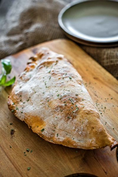 A delicious rustic looking calzone made with loads of ham and cheese, the perfect breakfast.