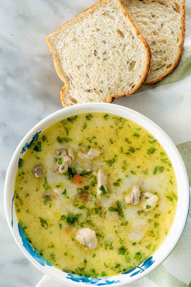 A bowl of Romanian soup with chicken and sour cream